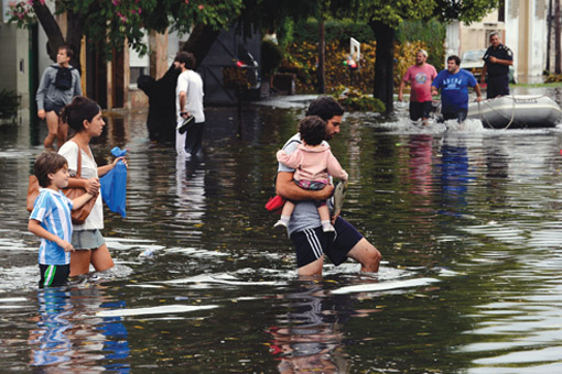 Heavy rains and flooding in La Plata, Argentina, claimed the lives of dozens in April 2013. Photo: Daniel Garcia/AFP/Getty